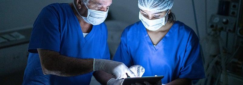 Clinicians-sharing-tablet